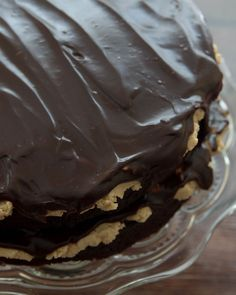 Peanut Butter Cup Cake-2 layers of chocolate cake each topped with a smooth peanut butter filling and chocolate ganache! So easy to put together!