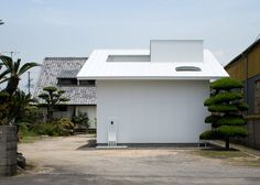 Japanese house extension arranged around a covered courtyard.