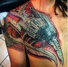 Biomechanical chest piece by Roman Abrego #InkedMagazine #