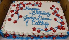 Red, White, & blue buttercream flowers and branches on sheet cake design.  100% BC.