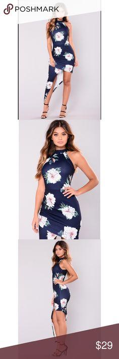 ❣️🌺 Beautiful Floral Asymmetrical Dress 🌺❣️ Beautiful floral dress 😍 when you wear this you will be the star of the show 🤩   • Floral Print Dress • Navy • High Neck • Asymmetrical • 95% Polyester 5% Spandex Fashion Nova Dresses Asymmetrical