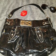 """⭐Sale⭐XOXO Studded Strap Satchel Cute studded strap with to slip andb1 zip pkt inside 12"""" H 16"""" W 5.5"""" D 100% sales go to a family from fraud. A single mom and her 3 kids were left destitute by her ex husband after he fled indictment by the FBI. No child support/alimony and no warning. Their whole life was a lie and now their left to pick up the pieces through foreclosure and repossession suffering his consequences as he runs free. XOXO Bags Satchels"""