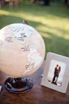 Globe wedding guest book idea for the travelers. Photographer: B&G Photography via The Knot