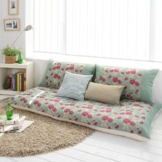 While designing your space use pillows with various patterns and colour schemes, but pick a common hue that appears in most of them to tie it all together.  #ColourfulHomeSpaces
