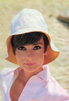 "Audrey Hepburn photographed by Pierluigi Praturlon in the French Riviera (Côte d'Azur), during the filming of ""Two for the Road"", in June -Audrey was wearing a hat of Hermès and shirt of Givenchy Nouvelle Boutique. Audrey Hepburn Born, Audrey Hepburn Photos, Divas, Paris Match, Wearing A Hat, Most Beautiful Women, Absolutely Stunning, Beautiful People, British Actresses"