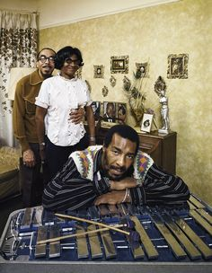 Richie Havens leaning on a xylophone with parents Richard and Mildred in the background in their home in East Flatbush, Brooklyn, New York. IMAGE: JOHN OLSON/THE LIFE PICTURE COLLECTION/GETTY IMAGES