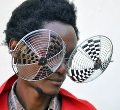 Cyrus Kabiru is a Kenyan sculptor and painter creating artworks from found objects.