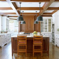 Love the beamed ceiling, the warm wood with white, the light fixtures and glass doors on the back wall.  Gorgeous!