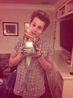 James McVey from the Vamps with Taylor's Grammy for Mean, meaning he is in her house, meaning he went from fanboy to friends. James The Vamps, Jamesy Boy, Evan And Connor, Brad Simpson, Ethel Kennedy, New Hope Club, Bestest Friend, Pop Bands, Taylor Alison Swift