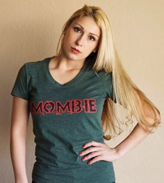 -a new tee version of our classic Mombie shirt-Printed on American Apparel 50/50 poly/cotton heather forest tees.-Slightly scooped neck and perfectly worn feel.-These are ladies sizes so they are made to be fitted. If you are unsure between two sizes, sizing up would probably be the safest bet. We always recommend using the measurements in the sizing chart. -Made with extra RADPhotography by Annette Bunch. -Ready to ship in approximately 3-5 days