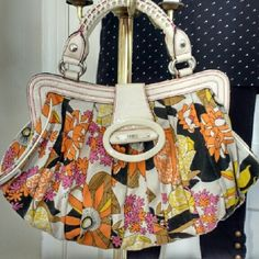 Guess Hippie Pattern Purse  Cream colored purse with bold floral pattern in pink, orange, yellow, brown and black.  Exterior is made of cloth and trimmed in cream patent leather with pink stitching.  Silver hardware/magnetic closure/interior pockets.  Unique lacing design on handles. In excellent condition, no marks or rips on exterior and only minor sign of use on inside (no rips or tears).  Great for spring!!   Feel free to ask questions should you have any!  XOXOXO Guess Bags Shoulder…