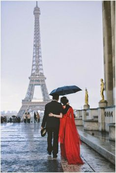 Lady in red in rain at Eiffel Tower, so romantic! ...