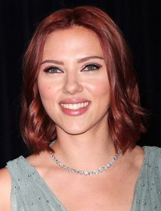 Scarlett Johansson deep auburn look and makes her green eyes pop with the vibrant red color.