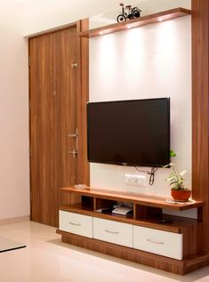 Living Room Tv unit: living room by yaama intart, Living Room Tv Unit Designs, Bedroom Cupboard Designs, Wardrobe Design Bedroom, Bedroom Furniture Design, Tv In Bedroom, Bedroom Tv Unit Design, Tv Unit Furniture Design, Room Door Design, Tv Wall Design