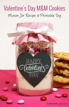 Valentine's Day M&M Cookies in a mason jar with free printables from Two More Minutes is just too cute.  LOVE!