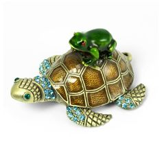 Sea Turtle and Frog Crystal Studded Pewter Jewelry Trinket Box by Welforth. $28.00. Perfect for collectors. Turtle and frog pewter trinket box with hinged top. Magnetic closure. Overall size 2.7 x 2.1 x 1.5 inches (LxWxH). Hand-applied enamel with sparkling crystal accents. Charming trinket box is made from pewter with hand applied enamel and sparkling crystals. The hinged top features a magnetic closure opening to a painted interior. Due to handcrafting, your box may diff...