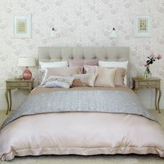 Dusky pink and greys makes such a beautifully feminine and chic room.