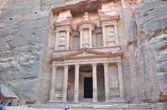 https://flic.kr/p/jJn9iu | Al Khazneh (The Treasury) | Al Khazneh is one of the most elaborate temples in the ancient Jordanian city of Petra. As with most of the other buildings in this ancient town -including the Monastery- this structure was carved out of a sandstone rock face. It has classical Greek-influenced architecture, and is a popular tourist attraction.  History  Al Khazneh was originally built as a mausoleum and crypt at the beginning of the 1st Century AD during the reign of…