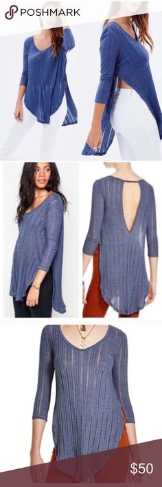 """Free People Blue Astoria Top Shirt Size Medium Free People Blue Astoria Top Shirt Size Medium 🔹New with tags 🔹 A hacci-knit top featuring slender, sheer ribbing gets its boho-chic shape from dramatic, fold-over side slits that emphasize the shirttail hem. A generous keyhole back finishes the light-as-air look. 31"""" length (size Medium). Scooped neck. Three-quarter sleeves. Side vents. Shirttail hem. Sheer; base layer recommended. 50% cotton, 50% polyester. Machine wash cold, dry flat. By…"""