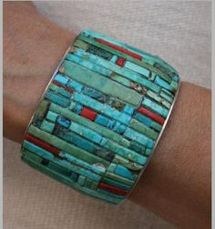 Cuff | Charles Loloma. Sterling silver inlaid with turquoise and coral.