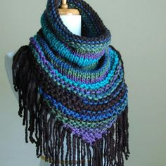 My new design combines my love of fringe triangle scarves, cowls and this wonderfully soft vegan yarn in Gorgeous shades of jewel tones. Not only would this be the perfect fall/winter accessory but it looks Great with a tank top and shorts for cool summer nights. So easy to wear, just throw it over your head and you're good to go!  Available in more colors!Matching slouch hats also available in the Hats section of my shop.  As with all hand knits I recommend: Hand wash, blot out exce...