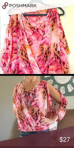 Jennifer Lopez Cold Shoulder top Size Xsmall Such a pretty flowing top with splashes of pink and orange . Pretty gold accents at the shoulders. Arms open at the sides.. looks beautiful with white capris or black pants ... perfect brand new condition!!! Can fit small or extra small because it's flowy.. Jennifer Lopez Tops Blouses