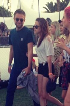 Twitter / orangeRK18: Love this glimpse of how in love Rob is with Kristen her trust of Rob as she holds onto him. New/old Coachella pic <3