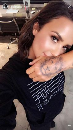 Demi Lovato gets a giant tattoo of a lion on her hand