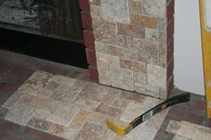 tile over tile | mosaic tiles at Lowe's to cover the red brick. I wanted the tile ...