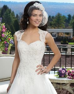 Sincerity / Wedding Dress / Style #3809 / Available Colours : Ivory, White - Alencon beaded lace over organza ball gown featuring a Queen Anne neckline. The gown is finished with a keyhole back, covered buttons over the back zipper and a chapel length train (close up)