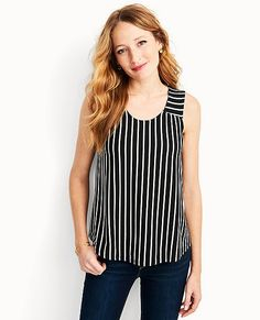Whether you pair it with jeans or nudge it towards an evening out, this comfy-gorgeous swing top elevates everything with its perfect black and ecru stripes.