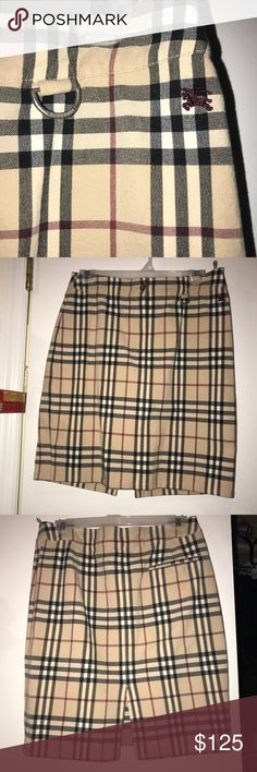 Burberry London Check Skirt Practically New! Amazing Condition! Slit in back. Pocket on right side of back. Make an offer! Burberry Skirts Midi