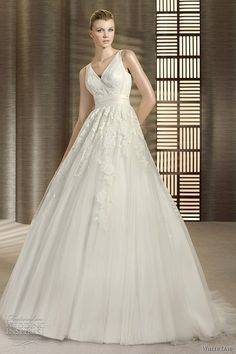 I like the top of this, not so much the bottom...  V-neck ball gown by White One.