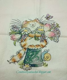 Margaret Sherry spring cat. Stitched by me.