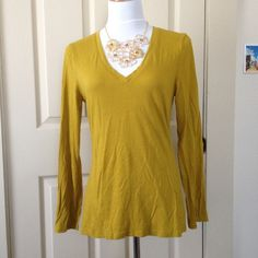 Old Navy Long Sleeved V Neck Top Perfect for layering, I wore this top maybe twice so great condition. Deep v neck so best worn with a tank underneath. Need measurements? New pictures? Have questions? Just ask!  Remember all items purchased on PM are final sale - the guarantee only applies to items that are grossly misrepresented by the seller. Old Navy Tops