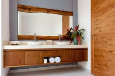 Terrazzo wash-table and recycled teak wood for mirror and cabinet for our indoor / outdoor bathrooms.