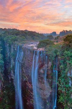 Sunset falls over Magwa Falls, near Lusikisiki, Wild coast, South Africa.