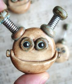 Interview with Robots Are Awesome, maker of mixed media creations combining polymer clay, coiled wire and paint. Awesome.