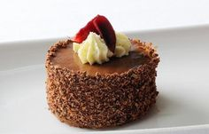 This enticing Black Forest gâteau recipe easily trumps the frozen version and gives the classic dessert a much needed makeover. A top layer of chocolate sponge gives way to a melange of extraordinary flavours. Serve with cherry sorbet for an added touch