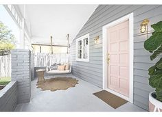 Wishing we could spend our afternoons here!! Colours: Stormy Shadow, Pink Dust, Snow Drop. . . . . . . #taubmans #thehillsarealivewithrenofive #pinkdoor #porch #porchswing #grey #pink #house #renovation #interiors #interiordesign #gold #threebirds #lifestyle #luxe