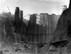 his is a view of the Hoover Dam from upstream as construction continued near Boulder City, Nev., Feb. 1, 1935. The crack in the upper center of the dam is a space left open for cooling and settling of the concrete and will be filled as work progresses. (AP Photo)
