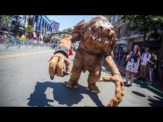 Making a Star Wars Rancor Costume for Comic-Con! - YouTube (Love that his handlers actually HELD HIS HANDS going down the street. Hee!)