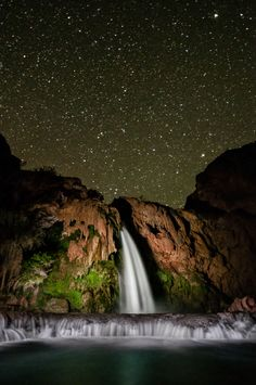To capture Havasu Falls in Arizona at night, the photographer left the shutter open for 55 seconds while David Hatfield used a flashlight to paint light on the waterfall and cliff. Photo by Travis Burke