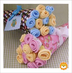 Baby Shower: Cute way to wrap bibs or burp cloths for baby shower gift.
