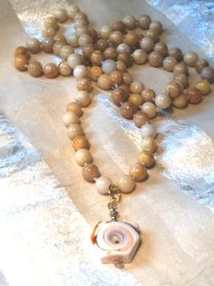 Endless Quartzite Necklace With Spiral Shell & by NorthCoastCottage Jewelry Design & Vintage Treasures on Etsy.com, 89.00