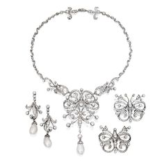 SET OF GOLD, SILVER, NATURAL PEARL AND DIAMOND JEWELS. Set with numerous old mine, old European, single and rose-cut diamonds and pearls. The set was adapted from a tiara, 19th Century; the tiara fitting, not illustrated, accompanies the set.