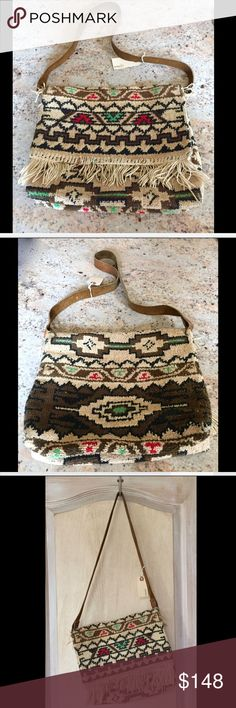 """Free People Vintage Loves  Bag 70's Fringe OOAK Free People Vintage Loves Vintage Carpet Bag from the 70's Fringe OOAK One Of A Kind 8 made out of Vintage Carpet with a brown leather strap tan, brown, black multi * inside is unlined with no slips retail price:  $168.00   * pic 1, 2, 3, 4 & 7 are the actual bag * in Fabulous condition for Vintage  12""""W  x  10""""H   x  3""""D 16.5"""" 1"""" leather strap drop Free People Bags Crossbody Bags"""