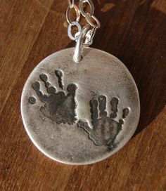 Give this custom first handprint (or footprint) necklace to a new mom or dad! #parents #gifts #baby