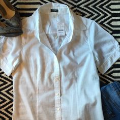 JCrew White button down shirt NWT. J Crew white shirt. Retails for 44.50. 100%cotton. Button down short sleeve. A must have in every ladies closet! J. Crew Tops Button Down Shirts