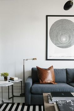 brass floor lamp and leather pillow \ Contemporary Modern Living Room: Leather pillow atop a couch in a contemporary living room.